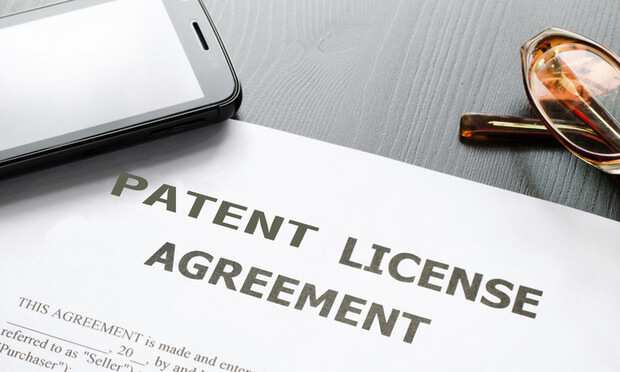 Patient License Agreement on Desk with Phone Glasses and Pen